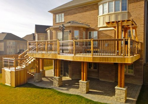 2 level cedar deck with pergola and landscaping