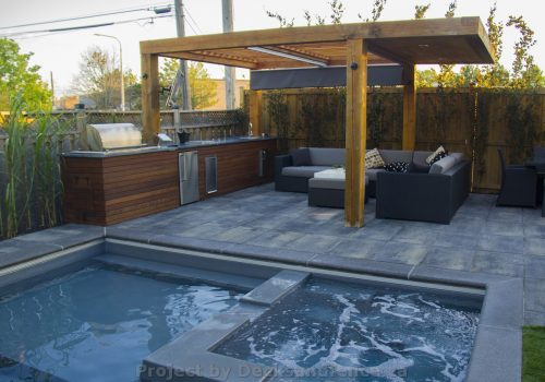 Outdoor kitchen with pergola pool and interlocking