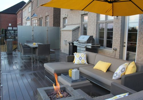 PVC deck with glass railings and firepit